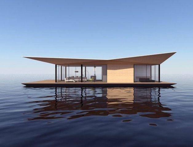 Desenhada por um especialista em projetos sobre a água, a casa flutuante possui estrutura de 128 m² e uma vista panorâmica possibilitada por suas paredes de vidro.