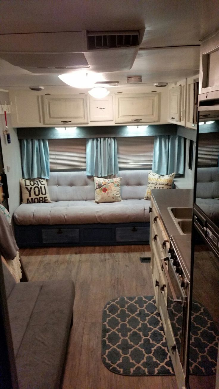 | Glamping | reupholstered couch in 5th wheel using dyed painters drop cloth, farmhouse, tiny home, renovation, camper curtains using dyed painters drop cloth, plank floors, futon, 120v lights, dinette and cabinets removed, gutted completely!