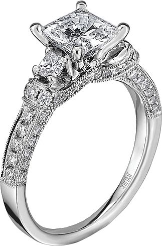 Scott Kay Three Stone Diamond Engagement Ring  : This diamond engagement ring setting by Scott Kay features a princess cut diamond set on each side of the center stone of your choice along with pave set round brilliant cut diamonds down the shank accented with a milgrain design.