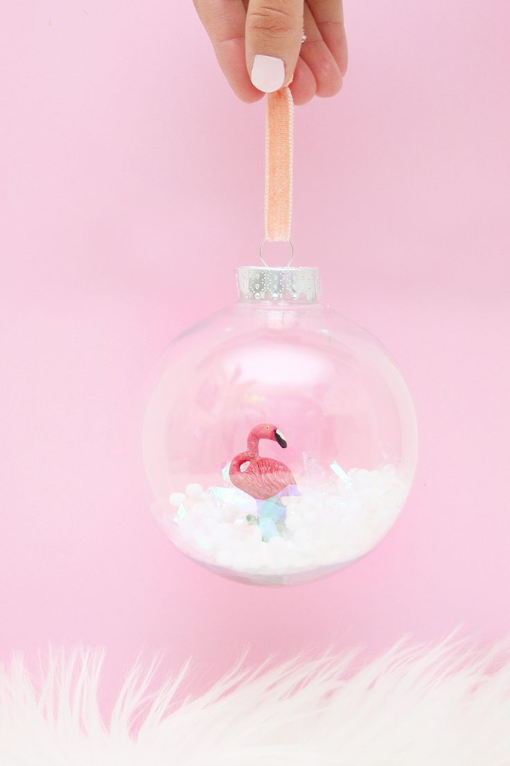 Follow this tutorial to make your own adorable DIY flamingo snow globe ornament because your Christmas tree needs a little pinik!