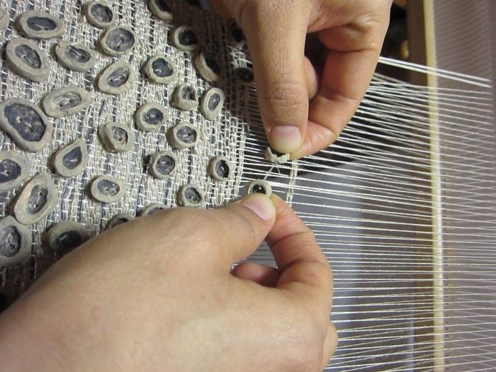 handmade clay beads added into weaving __ by Ana Montoya