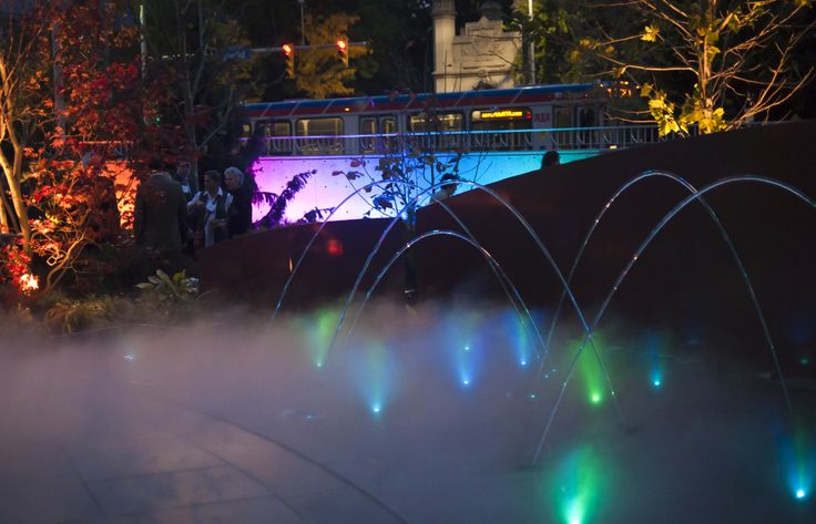 A wheelchair accessible, reflecting pool with misting mechanisms, leaping fountains and pop jets provides animation and softens traffic noise. Designed for all seasons using recaptured steam from the Cancer Center, digital sequencing facilitates rhythmic water patterns enhanced by lighting effects coordinated with accent and LED lighting sequences in the garden.