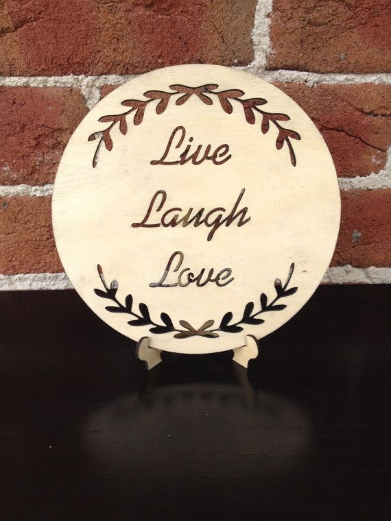 The cut out LIVE LAUGH LOVE timber plaque with wreath is created and designed by Katrina Louise Designs for Engagements, Weddings, gifts and decorations.