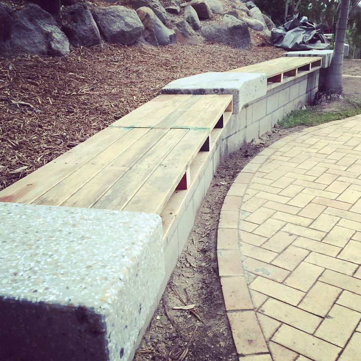 Reclaimed pallet styled benches with polished concrete inserts