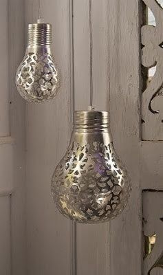 Art Cover a light bulb with a doily and spray paint it. The light will shine the pattern onto the walls. diy
