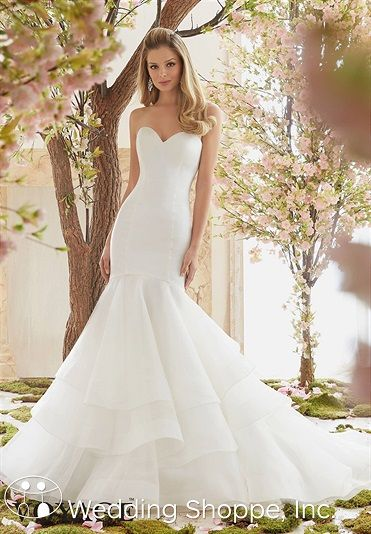 If you've got it, flaunt it. The Voyage by Mori Lee 6837 wedding dress is a curve-hugging stunner that celebrates the bride's luscious curves, showing them off in a sensual fit-and-flare silhouette.