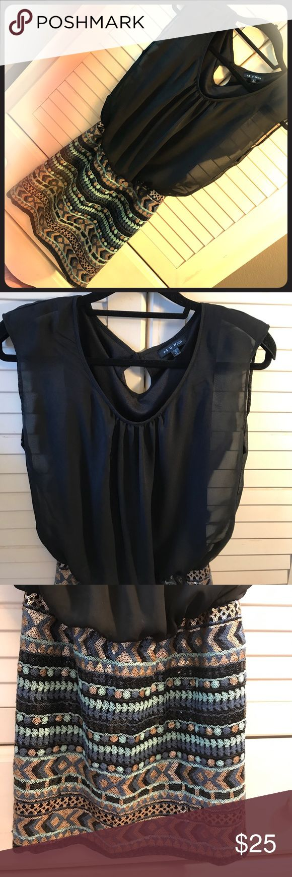 As U Wish Cleopatra Mini Black chiffon lined sleeveless top with single button closure in back. Beautiful sequined skirt giving it a Roman Era looking design, one of my favs! As U Wish Dresses Mini