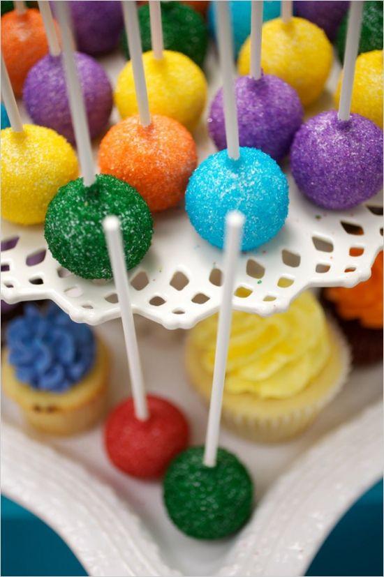 glitter cake pops at rainbow colored wedding #dessertbar #weddingreception #weddingchicks http://www.weddingchicks.com/2014/02/04/country-fair-wedding/
