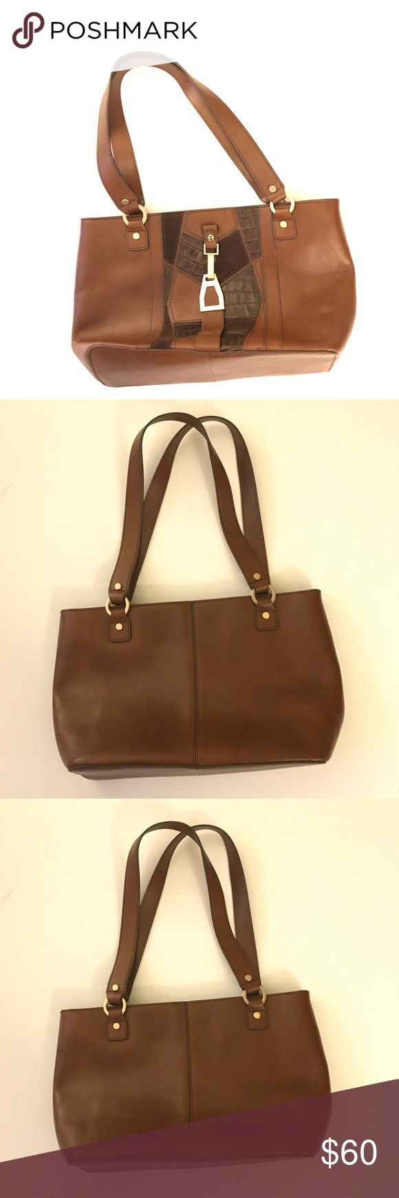 """NWOT Etienne Aigner Brown Shoulder Bag Gorgeous brown shoulder bag with detailing in the front! The bag is new and has never been used. It measures 16"""" inches wide and 9"""" in length. Etienne Aigner Bags Shoulder Bags"""