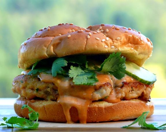 Pickled cukes and cilantro leaves give these salmon burgers crunch and an herby freshness.
