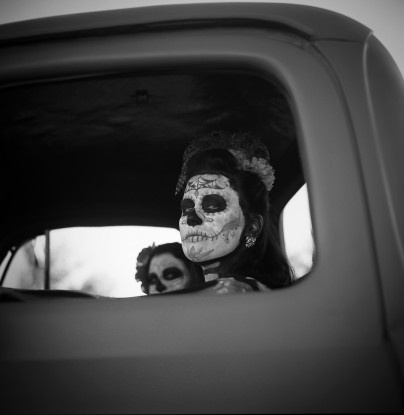 A girl, in a pickup, painted up for Day of the Dead? Amazing.