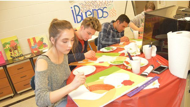 Photo by Orionna Brumfield/Natalie Fortenberry, Noah Spear, David Madrid and Natalie Brown in Tiffany Brooks' Spanish II and Leslie White's Spanish III class enjoy painting their canvases  from the instructions of Brookhaven native Josh Brister and his Spanish wife, Lucia Duque Brister.