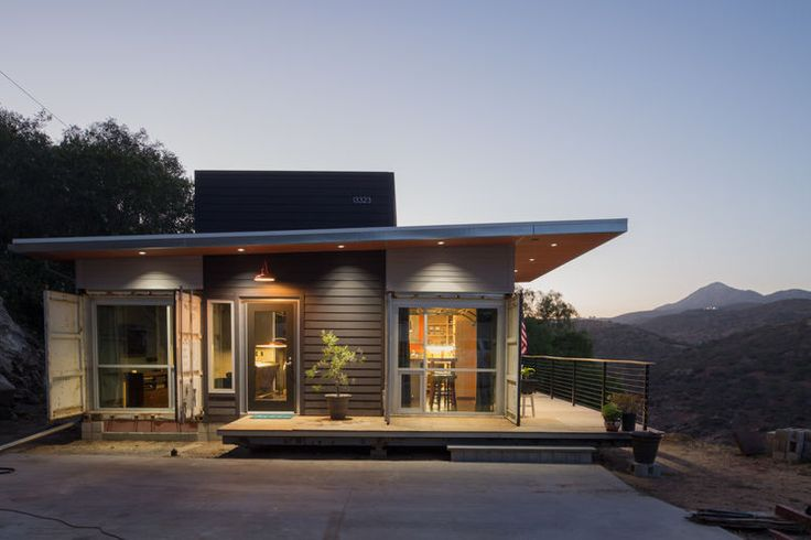 A rugged shipping container home in a remote locale.