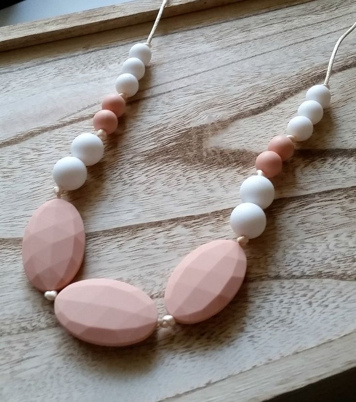 Silicone Teething Necklace - Teething Necklace for Mom - Teether for Baby - Silicone beads - Chewlery - Chewbeads - Peach and White - Baby by ShopSweetpeaandSugar on Etsy https://mammahealth.com/teething-baby-symptoms-remedies/