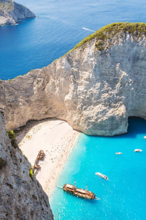 Located in a remote cove on Zakynthos in Greece's Ionian Islands, Navagio Beach gets its nickname—Shipwreck Beach—because of the ship that ran aground here in the 1980's.