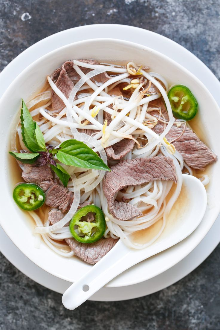 Let me start by saying: this is not real pho. Real pho is a lengthy process that involves gently simmering beef bones, various cuts of meat, charred onions and other aromatics for hours to produce a clear and yet richly flavored and lightly spiced broth. If you've never had real pho, I highly recommend seeking out the nearest Vietnamese restaurant and diving into a bowl as soon as possible. Dare I say it is more satisfying than chicken soup? Those spices are everything. Remember that the...