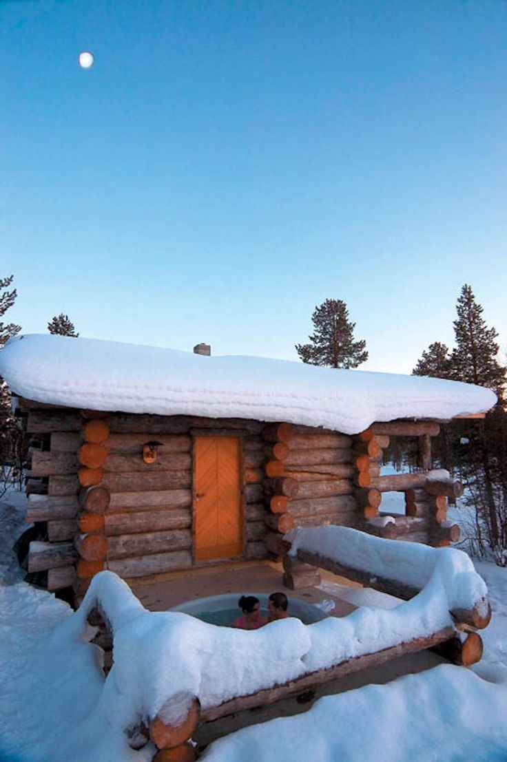 Outdoor hot tub in the winter surrounded by snow in Finland