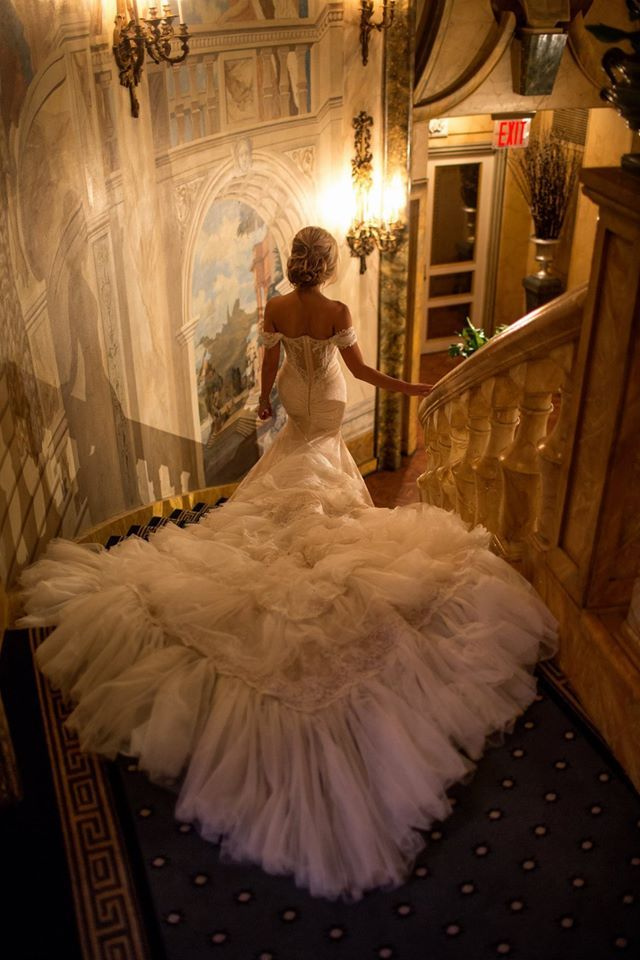 Not so into the dress or scenery, but the staircase and photo from behind is everything.  We need a staircase, and a look back at it - the camera :-}... -Kelly
