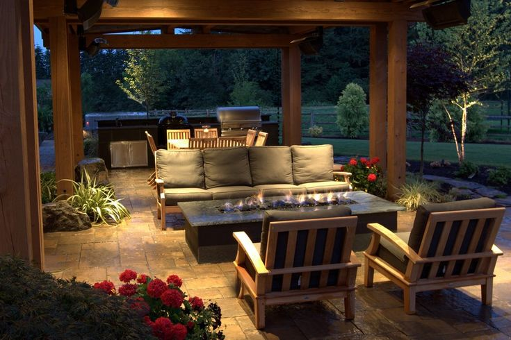 Stunning gas fire pit beneath a covered patio of a Seattle ...
