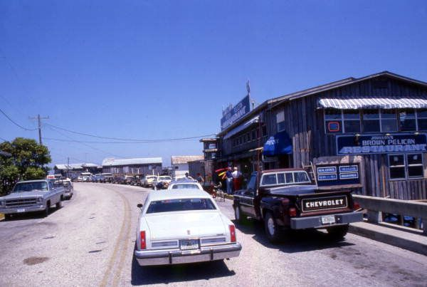 Florida Memory - View looking east along Dock St. in Cedar Key, Florida - Note the Brown Pelican Restaurant in the foreground at the right - Dock Street is also a 2-Way Street