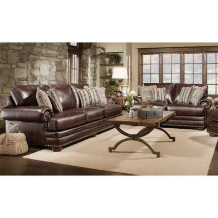 Brown Leather Sofas With White Rug Dark Hardwood Floors Stone Accent Wall