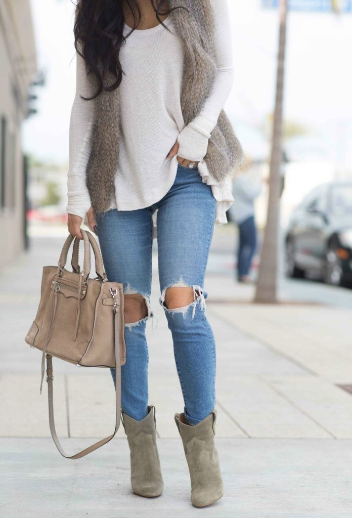 Perfect grey Winter day lights--skinny distressed light rinse jeans, a lightweight cream colored sweater, taupe faux fur vest, taupe tote, & taupe colored ankle boots.  Long diffused, scrunched curls because they take 10 min and look good all day!  Weekend perfection.