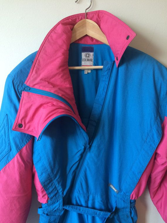 This is an amazing pink and and blue vintage 80s COLMAR ski suit, made in Italy. Zips up with an assymetrical zipper and has belted waist. Very