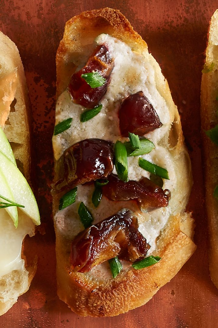 Rich blue cheese and sweet dates make this one decadent dish.  Recipe: Blue Cheese and Date Crostini   - CountryLiving.com