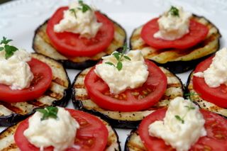 """Grilled Eggplant with Fresh Tomato and """"Herbed Cheese""""  (use your own vegan cheese or hummus). Top with oregano or thyme leaves."""