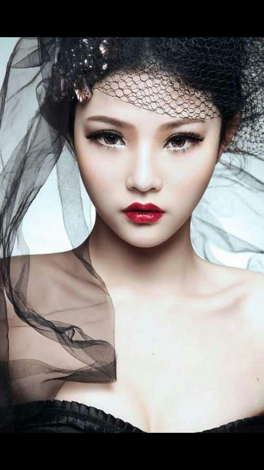 Love that red lipstick on the pale Asian skin tone.