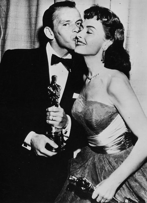 """1953 Oscar Winners - Frank Sinatra  Donna Reed with their Academy Awards for Supporting Actor and Actress in """"From Here To Eternity"""" 1953."""