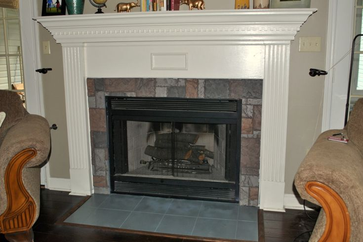 DIYd faux stone fireplace and spray painted slate hearth I