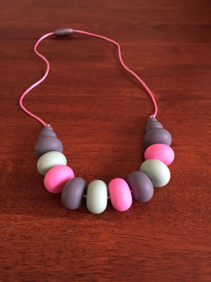 Fussy Little Fox Abacus Teething Necklace in pink, mint and grey on pink nylon cord with silver safety catch. $25 + Free Shipping within Australia. Visit Fussy Little Fox on Facebook to see more or email fussylittlefox@gmail.com to purchase.