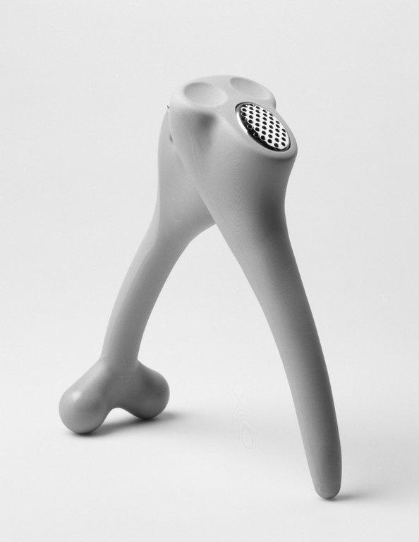 "Guido Venturini (Italian, born 1957). Garlic press,'""Nonno di Antonio,""  Model GV04, Designed 1996. Acetalic resin, stainless steel, height: (18.0 cm); diameter: (5.5 cm). Brooklyn Museum, Alessi"