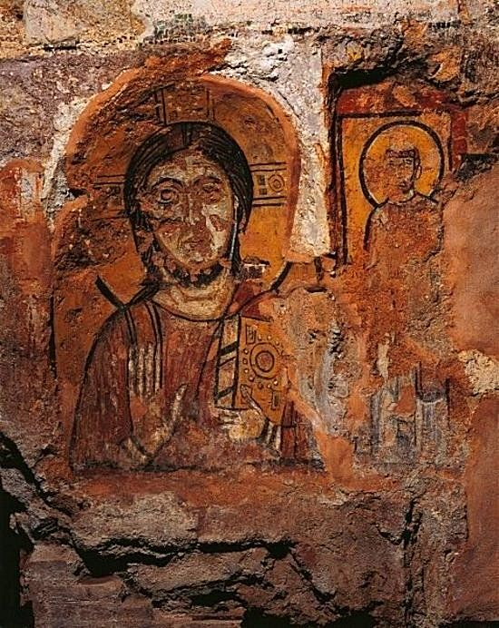 Christ Pantocrator fresco from the 4th or 5th century in the crypt of Saint Cecilia - St Callixtus catacomb.