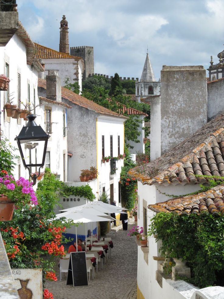 Obidos, Portugal- One of my favorite small towns in Portugal. Dont forget to try the Ginjinha with the chocolate shot glasses.. so much fun!