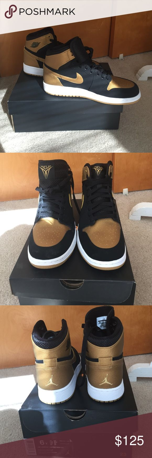 Air Jordan 1 Retro High Melo Nike BNIB BNIB women's size 7 Air Jordan 1 Retro. Black with gold colorway. Never Worn! Sad to see these babies go! Nike Shoes Athletic Shoes