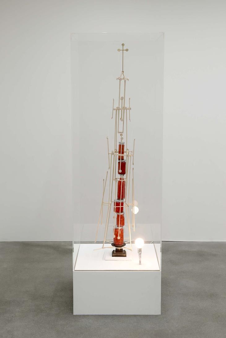 Björn Dahlem - Cathedral Cathedral (2008), a towering wooden assemblage fixed around a teetering pile of jars of glacier cherries, is a made-up model of a parallel reality, rife with an absurd, incomprehensible instability.