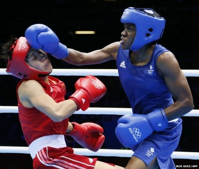 Cancan Ren of China and Nicola Adams of Great Britain fight during the women's boxing Flyweight final