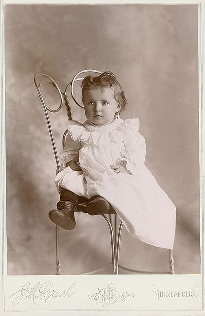 +~+~ Antique Photograph ~+~+  Baby girl sitting on an ice cream parlor chair.