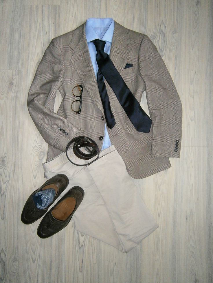 brown glencheck wool jacket / beige chinos / light blue long arm shirt / navy blue silk tie / blue cotton handkerchief / dark brown loafers / brown leather belt / white blue pinstripe socks / tortoiseshell glasses