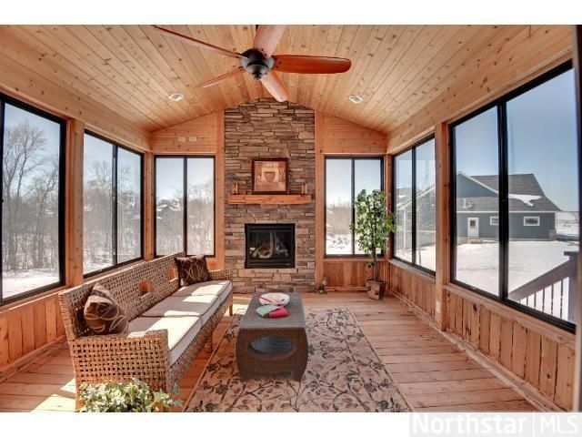 17 best images about sunrooms on pinterest covered for Sunroom with fireplace designs