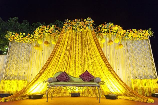 Vibrant yellow stage backdrop | The Maharani Diaries
