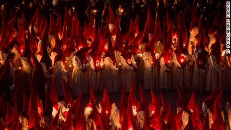"""Penitents take part in the """"Procesion del Silencio"""" (Silence Procession) by the """"Cristo de las Injurias"""" brotherhood, during the Holy Week in Zamora, Spain, Wednesday, April 1, 2015. Hundreds of processions take place throughout Spain during the Easter Holy Week."""