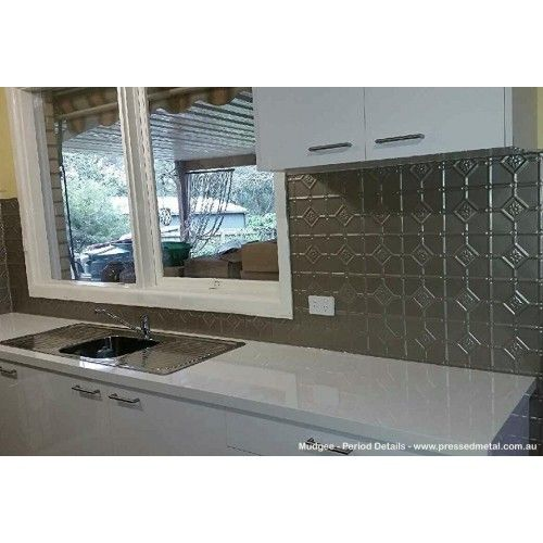 The Mudgee pattern pressed metal powdercoated in Dulux Precious Champagne Kinetic Pearl looks opulent in this kitchen.  With it's lovely metallic finish it provides a wonderful lustre to this splashback.  For sizing and pricing go to www.perioddetails.com.au