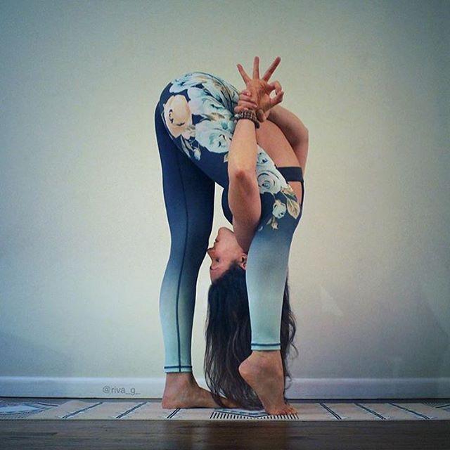 Standing yoga pose. Forward fold variation.