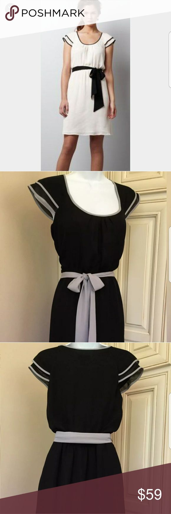 ANN TAYLOR LOFT FLUTTER SLEEVE DRESS SIZE 10P BRAND NEW NEVER WORN. GORGLRS BLACK DRESS WITH DOVE GRAY PIPING DETAIL ON THE SLEEVES TO MATCH THE CHIFFON BELT. SIZE 10P. ANN TAYLOR LOFT Dresses