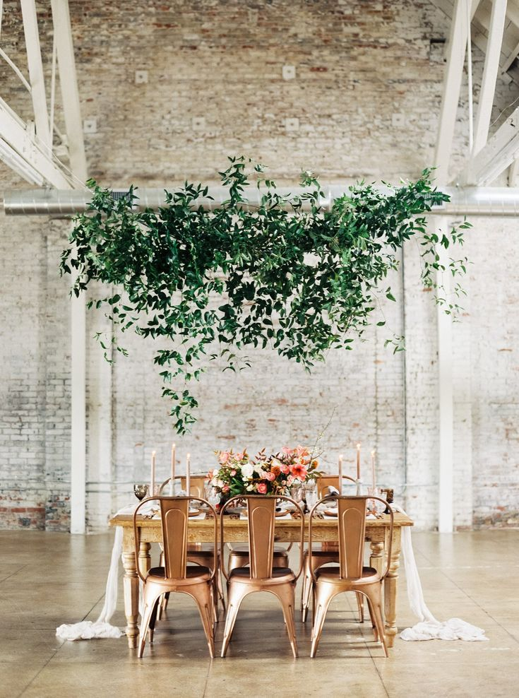 Hanging greenery makes for beautiful wedding reception ceiling decorations. Opt for suspended wreathes, garlands, or greenery chandeliers for your wedding.