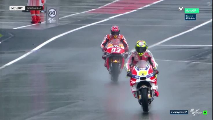 Malaysian GP Race - New Sighting Lap Andrea Iannone and Marc Marquez