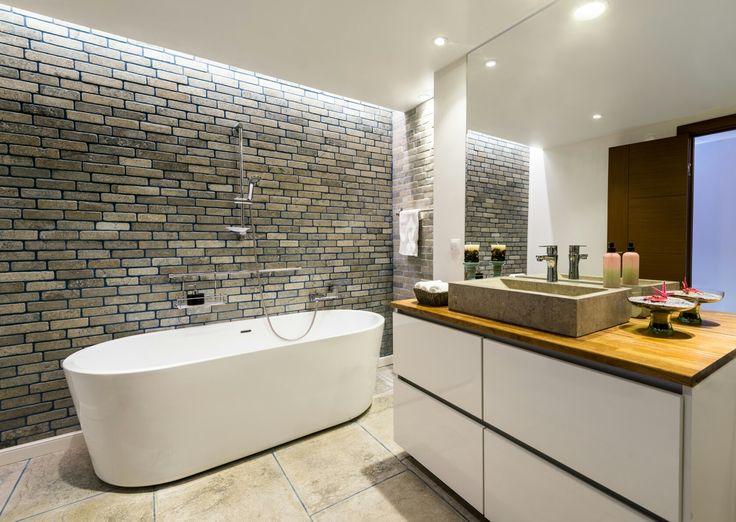 Grey limestone bathroom with bricks and big tumbled and brushed finish